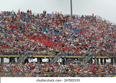 Newton Iowa, USA - June 23, 2013: Indycar Iowa Corn 250 race Iowa Speedway, fans watching high speed competition. Stadium, arena