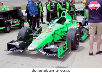 Newton Iowa, USA - June 23, 2013: Indycar Iowa Corn 250 pre-race and gridding cars, Iowa Speedway. James Hinchcliffe Toronto GoDaddy