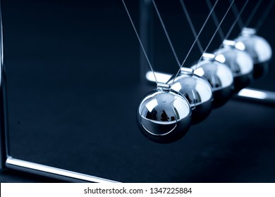 Newtons Cradle balancing balls, business concept in studio