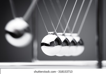 Newton's cradle physics concept for action and reaction or cause and effect