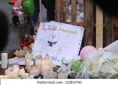 NEWTOWN, CT., USA, DEC 16, 2012: Sandy Hook Elementary School shooting, Memorial sign with assorted gifts, Dec 16, 2012 in Newtown, CT., USA