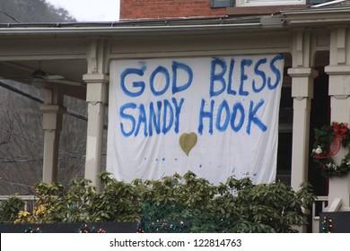NEWTOWN, CT., USA, DEC 16, 2012: Sandy Hook Elementary School shooting, God Bless Sandy Hook hanging sign, Dec 16, 2012 in Newtown, CT., USA