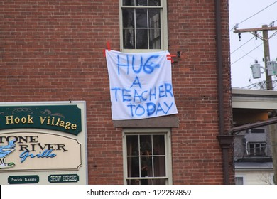 NEWTOWN, CT., USA-DEC 16: Sandy Hook Elementary School shooting, Hug a Teacher hanging sign, Dec 16, 2012 in Newtown, CT., USA