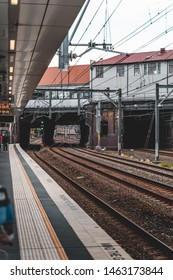 Newtown, New South Wales - JUNE 23rd, 2019: Waiting for the train on a cloudy day at Newtown Station.