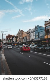 Newtown, New South Wales - JUNE 23rd, 2019: Weekend traffic travelling through Newtown on King St on a sunny weekend.