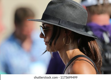 NEWTOWN SQUARE, PA-SEP 6: Pole vaulter Allison Stokke waits for Rickie Fowler after the first round of the 2018 BMW Championship on September 6, 2018 in Newtown Square, Pennsylvania.