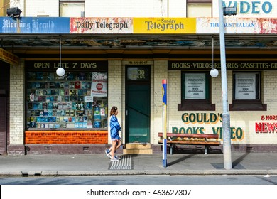 Newtown, Sydney, Australia, May 15th, 2016. A Girl walking in front of a video store in Sydney suburb.