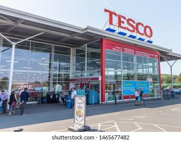 Newtown -  Wales / UK - July 23rd 2019 - Shoppers outside Tesco supermarket entrance