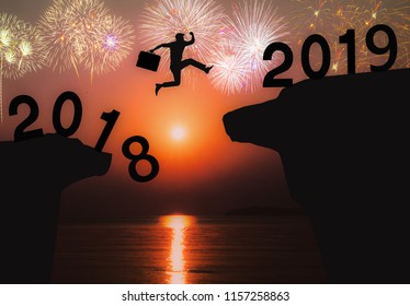 Newyear 2019 concept Businessman jumping to 2019 new year