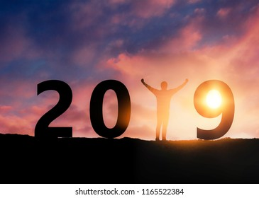 Newyear 2019 concept Silhouette young man Standing to 2019 new year