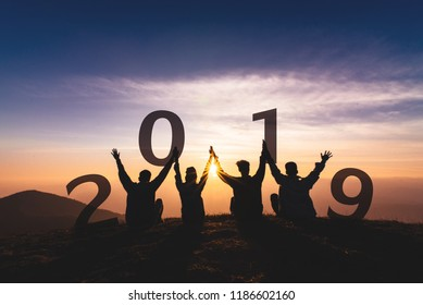 Newyear 2019 concept Silhouette of young friend jumping and hand shake for celebrate new year party.