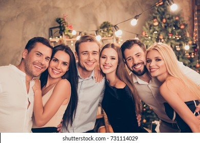 Newyear, noel, x mas time! Group of six festive youth gathered indoors on fancy feast, classy outfits, chilling relax mood all night, indoors event, bright illumination, decorations