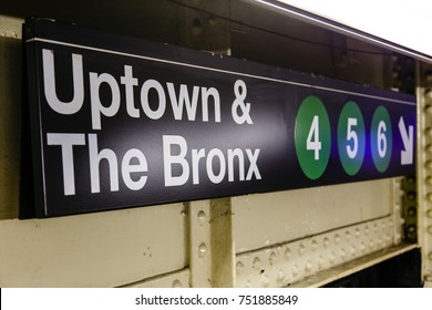 New-York - 13 NOV: Sign in a New-York subway station marking the way to Uptown & The Bronks trains in New-York, USA on 13 November 2012.