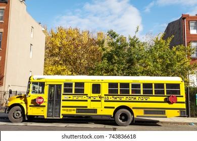 NEW-YORK - NOV 14: School bus belonging to the Ahavat Israel Yeshiva for girls parked in Brooklyn, New-York, USA on November 14, 2012.