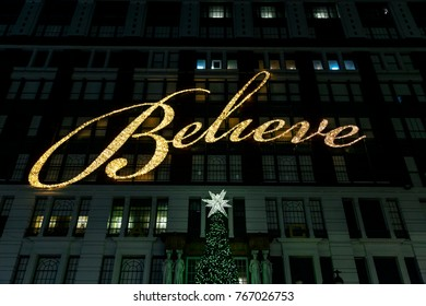 """NEW-YORK - NOV 15: """"Believe"""" light sign and Christmas tree above Macy's department store entrance in New-York, USA on November 15, 2012."""