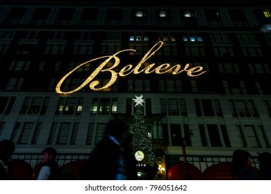 "NEW-YORK - NOV 15: ""Believe"" light sign and Christmas tree above Macy's department store entrance in New-York, USA on November 15, 2012."