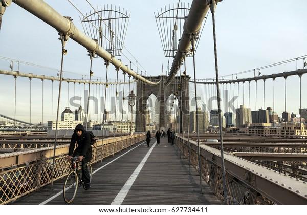 NEW-YORK - NOV 15: People walking on the pedestrian/bicycle path on Brooklyn bridge in New-York, USA on November 15, 2012.
