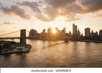 New-York skyline and Brooklyn bridge at sunset
