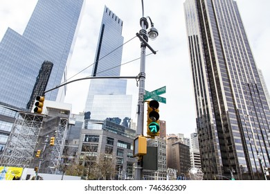 New-York, USA - NOV 19: Low angle view of the street and skyscrapers in the intersection between Central Park West and Colombus Circle on November 19, 2012 in New-York, USA.