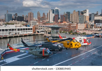 NEW-YORK, USA - SEPTEMBER 29, 2009: Military airplanes and helicopters displayed on the USS Intrepid Museum desk. New York City. USA