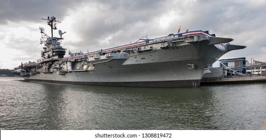 "NEW-YORK, USA - SEPTEMBER 29, 2009: Large panoramic view of USS Intrepid aircraft carrier museum, also known as The Fighting ""I"" at sunset time. Manhattan, New York City. USA"