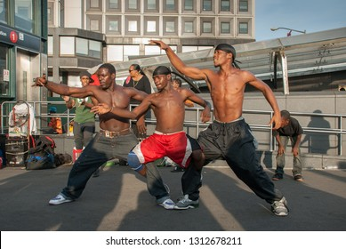NEW-YORK, USA - SEPTEMBER 29, 2009: Group of afro-american persons dance at Battery Park close to ferry station. New York. USA