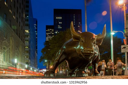 NEW-YORK, USA - SEPTEMBER 29, 2009: Charging Bull or Wall Street Bull or the Bowling Green Bull stands in the Financial District in Manhattan, New York City
