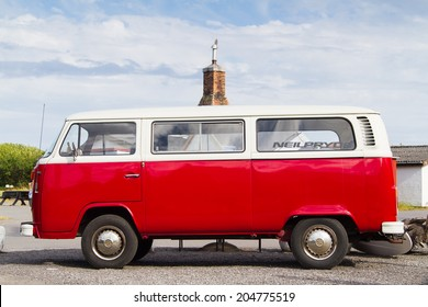 NEXO, DENMARK - JUNE 20: VW transporter T2 parked in Nexo, Bornholm, Denmark on June 20, 2014. The famous mini bus was manufactured for almost 64 years in 1949-2013.