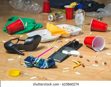 Next morning to a party. Horrible mess and chaos after crazy night at partying and drinking. Trash, bottles, food, cups and clothes on the floor. Messy hangover or drinker's remorse concept.