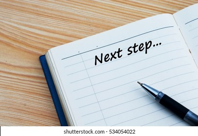 Next step text written on a diary