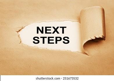 Next Steps written behind a torn paper