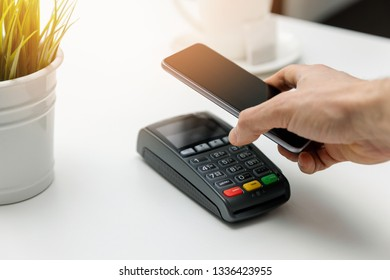 nfc contactless payments - paying bill with phone
