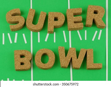 NFL football theme with block letters made out of cork on a green background. Background has randomly placed yard markers and hash marks. The words Super Bowl are spelled. Great for Super Bowl party
