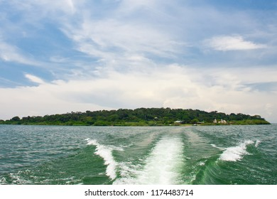 Ngamba Island, home of a chimpanzee colony on Lake Victoria, as seen from a moving boat, Uganda