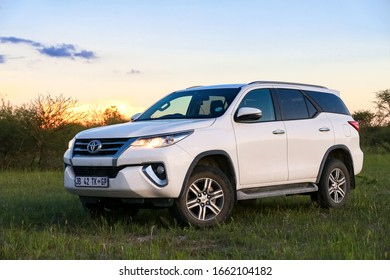 Ngamiland, Botswana - February 9, 2020: White offroad car Toyota Fortuner at the countryside.
