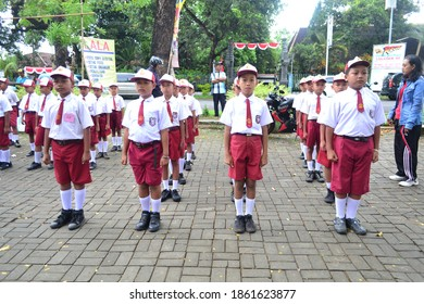 NGANJUK, INDONESIA - AUGUST 13, 2018: Baris berbaris and Gerak Jalan are the elementary school tradition in Indonesia.