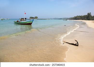Ngapali beach Myanmar showing local fishing boats. This beach area is Myanmar (Burma) most popular beach resort area.
