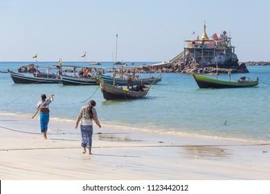 NGAPALI, MYANMAR - DECEMBER 03, 2014: Fishing boats in Thandwe village, Ngapali beach, Myanmar