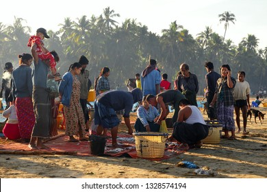 NGAPALI, MYANMAR - JANUARY 12, 2019: Local trade in the fishing market on the coast of the sea near the village of Ngapali, Myanmar