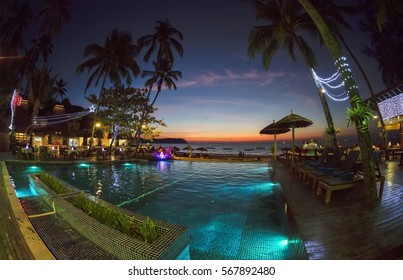 NGAPALI, MYANMAR - JANUARY 5, 2017: People enjoying the sunset in Amata Resort Hotel in Ngapali. With its palm-tree-fringed white sand Ngapali has a justified reputation as Myanmar's premier beach.