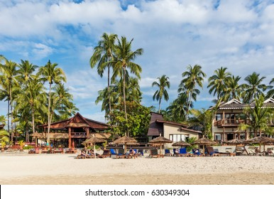 NGAPALI, MYANMAR - JANUARY 5, 2017: Sandy beach of Ngapali. With its palm-tree-fringed white sand, the clear waters of the Bay of Bengal Ngapali has a justified reputation as Myanmar's premier beach.