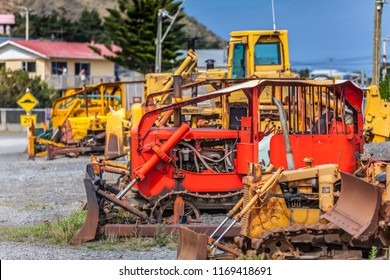 at Ngawi Harbour, New Zealand, north Island, the local beached fishing fleet is launched to sea by old, rusty bulldozers