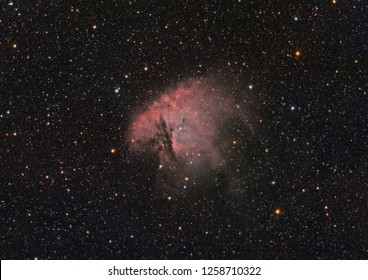 NGC 281 nebula in Cassiopeia constellation, taken by telescope with an huge amount of colored stars as background.