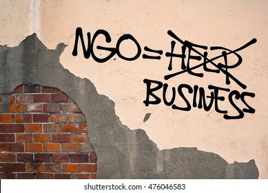 Ngo is Business - Handwritten graffiti sprayed on wall, anarchist aesthetics - Critique of Non-governmental organizations - lack of transparency, scandal with funding and donating