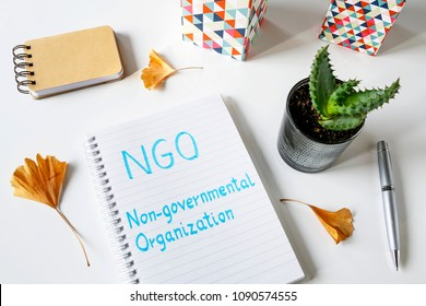 NGO Non-Governmental Organization written in notebook on white table