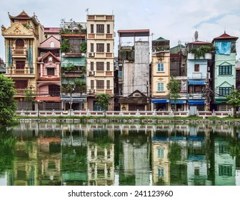 NGOC HA VILLAGE, HANOI, VIETNAM - 30 JULY 2013: Traditional houses overlook the small lake in the centre of the village where a B52 bomber aircraft, shot down during the war still lies