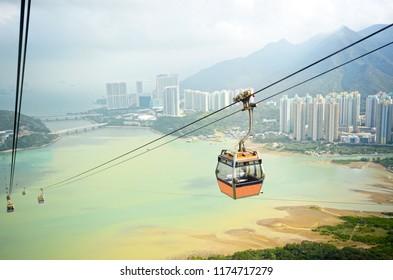 Ngong Ping cable car with ocean background, Hong Kong China