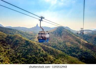 Ngong Ping cable car with Tian Tan big buddha statue in Lantau Island, Hong Kong China.