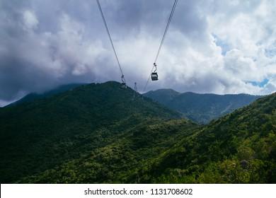 Ngong Ping, Lantau Island, Hong Kong - July 4, 2018: Ngong Ping Cable Car above Lantau Island's  North Country Park
