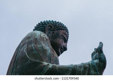 Ngong Ping, Lantau Island, Hong Kong - July 4, 2018: Side view of Tian Tan Buddha